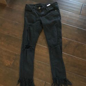 Black ripped jeans with fringe